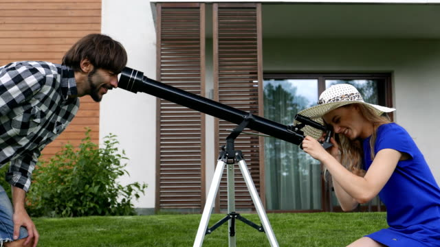 playful couple with a telescope video