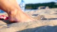 Playful female feet in the beach sand video