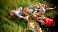 Playful Girls Laying In Grass, Have A Fun Tickle Fight video