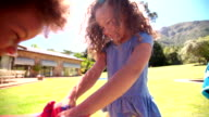Playful girls with finger paint on hand video
