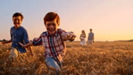 SLO MO Playful kids running in the field video