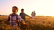 SLO MO Playful kids running in the wheat field video
