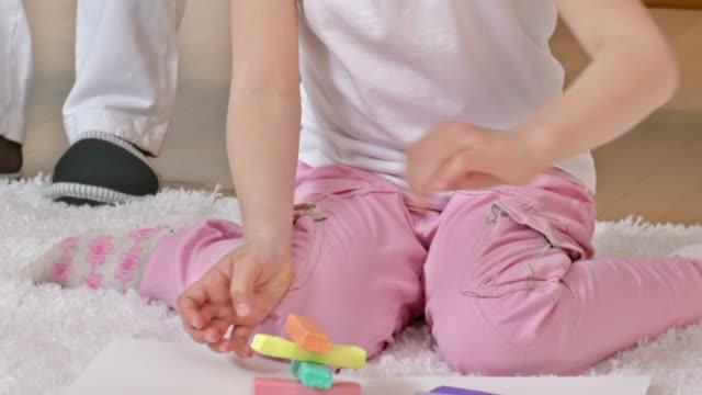 HD: Playful Little Girl And Modern Elderly Woman video
