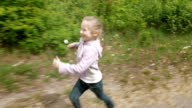 Playful little girl runs on game laughs and smiles video