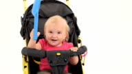 Playful Little Girl Sitting In Pram And Playing With Toy Spade video