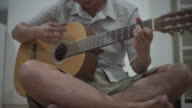 Playing accoustic guitar video