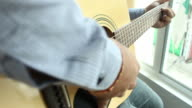 Playing acoustic guitar video