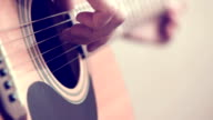 playing an acoustic guitar close-up video