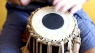 Playing Bongo drum close up HD stock footage. Hand tapping a Bongo drum in close up. video
