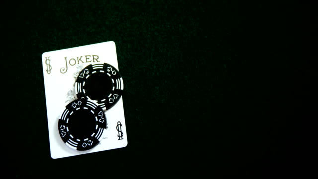 Playing card, dices and casino chips on poker table 4k video