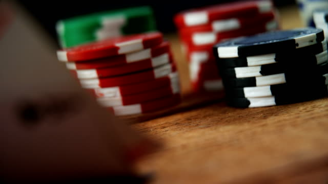 Playing cards and casino chips on poker table 4k video