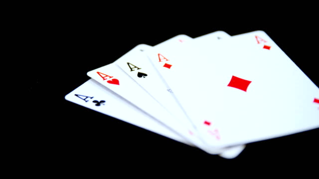 Playing cards arranged on poker table 4k video