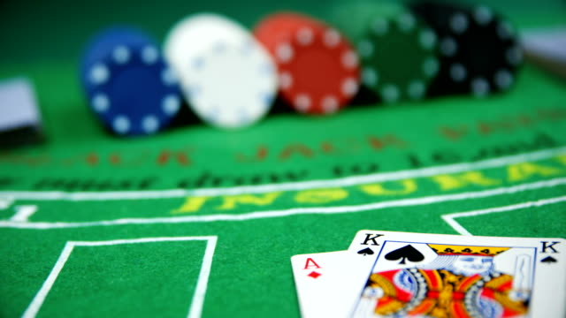 Playing cards, dices and casino chips on poker table 4k video