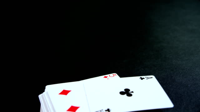 Playing cards on poker table 4k video