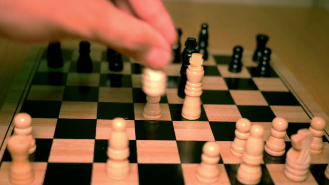 Playing chess with red color tone video