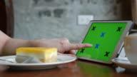 Playing digital tablet ,green screen,chroma key video