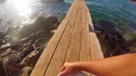 Playing Frisbee at seashorePOV, slow motion video