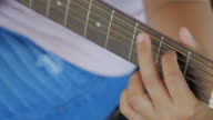 Playing guitar video
