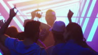 DJ Playing Music in Nightclub, People Dancing, Having Fun and Raising Hands. video
