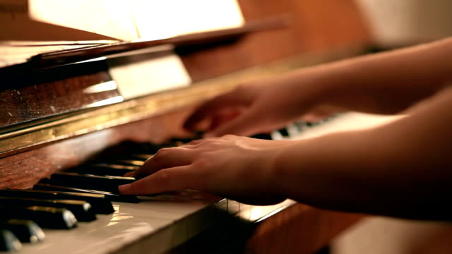 Playing piano pan shot video