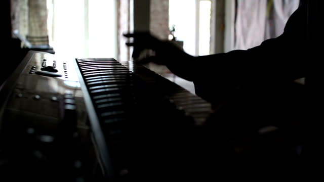 playing piano with two hands video