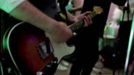 Playing ska rock music concert gig. Man hands play electric guitar pressing note chords close-up. Guitarist fingers hold pick stum strings intensively. Boys band performs at prom party video