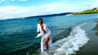 Playing, swimming and enjoying the delights of the beautiful sea video