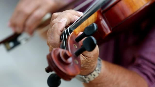 playing the violin in extremely close up video