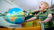 Playing with a globe video