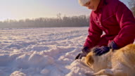 WS Playing With A Puppy In Snow video