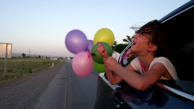 Playing with balloon on car video