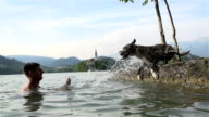 Playing with dog by a lake video