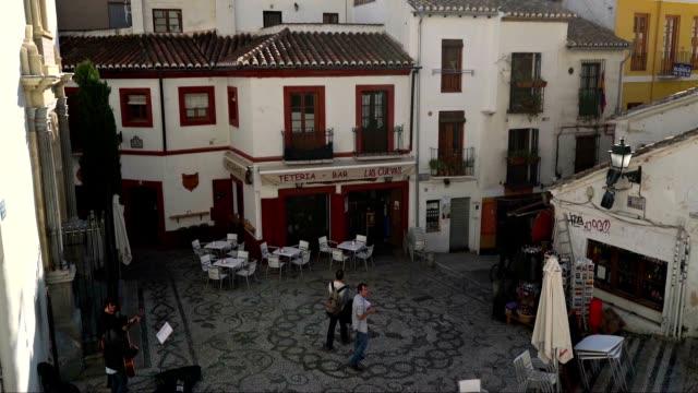 Plaza San Gregorio, entrance to the Medina market in the Albayzin of Granada, Spain. video