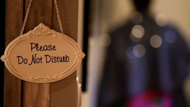 Please do not disturb sign in a hotel video