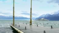 Pleasure boat sailing Lake Geneva, low season at Alpine resort, slow motion video
