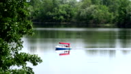Pleasure boat with a people floating in the bay. video