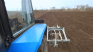 Rural farmland and tractor ploughing video