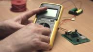 Plug in probes in digital multimeter video