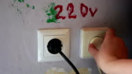 Plugging and sticking a plug into a socket video