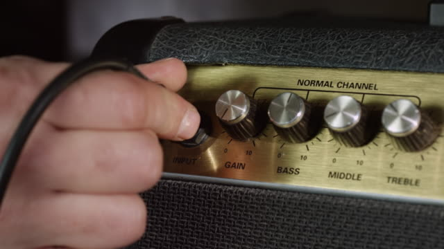 Plugging cable jack in guitar amplifier video