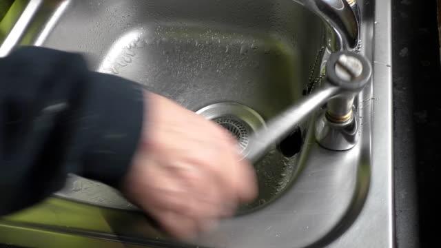 Plumber changing sink tap valve video