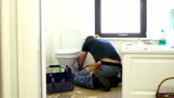 HD DOLLY: Plumber / Handyman fixing the Toilet in Bathroom video