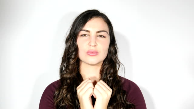 Plus size model woman blowing kiss towards camera - fun and happy video