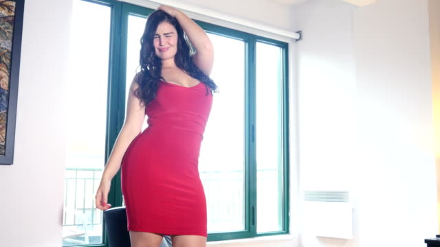 Plus size model woman dancing and feeling positive video