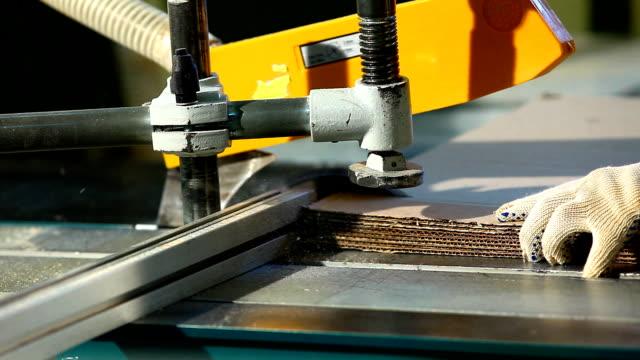 plywood factory - circular saw close-up cut paper video