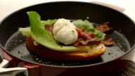Poached egg with bacon on bread, video