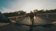 Point of view POV bicycle on Tiber bridge in Rome video