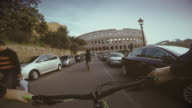 Point of view POV bicycle ride to Coliseum of Rome video