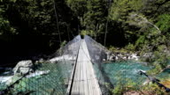 Point Of View Crossing a Suspension Bridge in New Zealand video