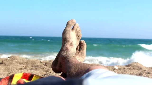 Point of view of man lying down on the beach video